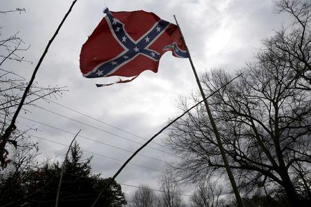 A Confederate battle flag flies in front of a home in Liberty