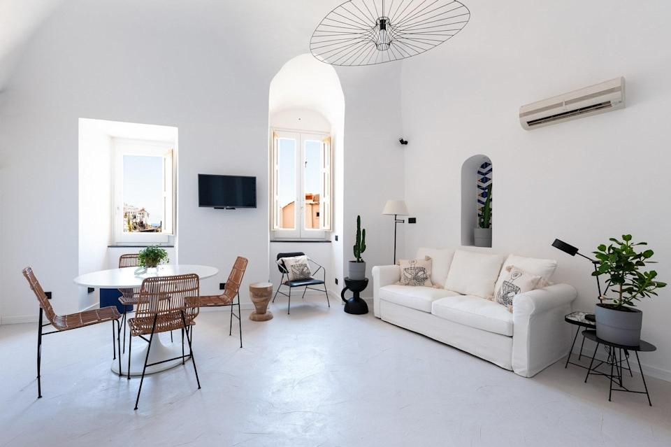"""Cozy up in this chic, white Airbnb in Amalfi, which offers incredible views of the town below, colorful tiled nooks, a kitchenette, and a double bed. You'll want to spend as much time relaxing together in the apartment as exploring what's outside. That said, Amalfi's beach and ferries, which take you to the other coastal towns nearby, are less than a 10-minute walk away. (To note, that walk includes about 100 steps downhill that you will later have to hike back up, so fill your <a href=""""https://www.cntraveler.com/gallery/8-best-travel-backpacks?mbid=synd_yahoo_rss"""" rel=""""nofollow noopener"""" target=""""_blank"""" data-ylk=""""slk:daypack"""" class=""""link rapid-noclick-resp"""">daypack</a> accordingly.) $334, Airbnb (Starting Price). <a href=""""https://www.airbnb.com/rooms/36169784"""" rel=""""nofollow noopener"""" target=""""_blank"""" data-ylk=""""slk:Get it now!"""" class=""""link rapid-noclick-resp"""">Get it now!</a>"""