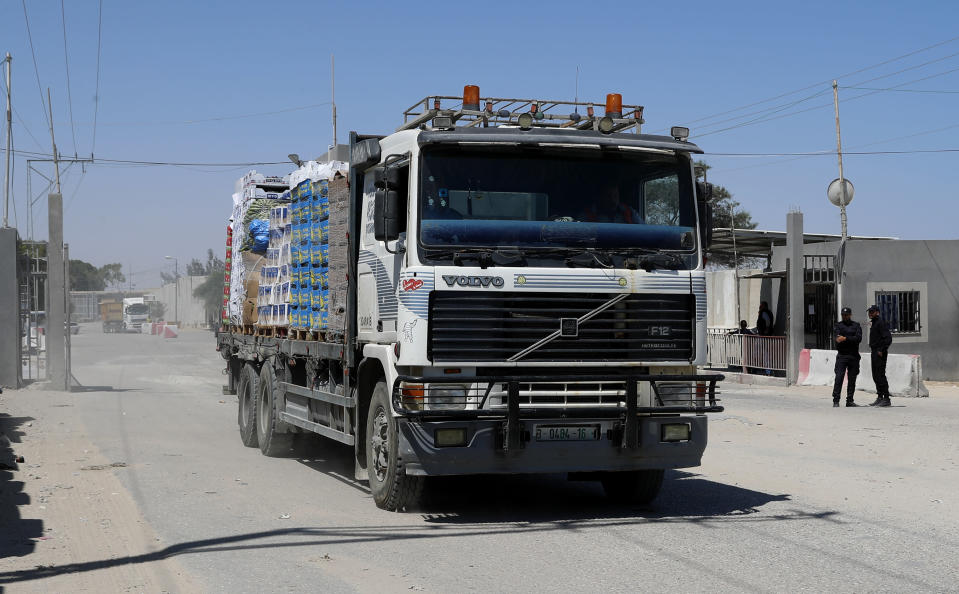 A truck carrying fruits and vegetables enters Gaza at the Kerem Shalom cargo crossing with Israel, in Rafah, southern Gaza Strip, Monday, June 21, 2021. Israel on Monday eased some restrictions on the Gaza Strip that have threatened a fragile cease-fire which halted an 11-day war last month with the territory's Hamas rulers, Palestinian officials said. (AP Photo/Adel Hana)