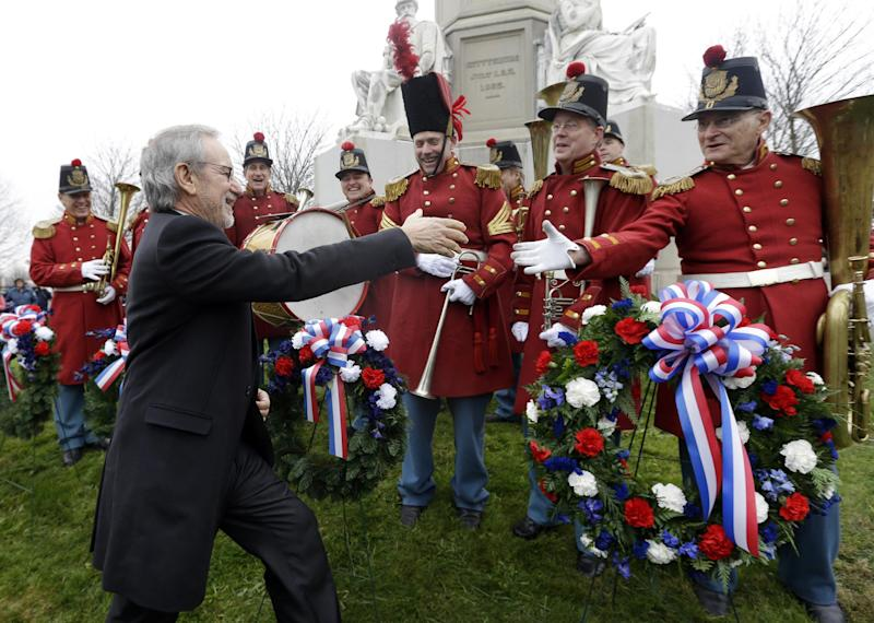 """FILE - This Nov. 19, 2012 file photo shows director Steven Spielberg, left, greeting members of """"The President's Own Band,"""" a musical group of Civil War re-enactors, during a ceremony to mark the 149th anniversary of President Abraham Lincoln's delivery of the Gettysburg Address at Soldier's National Cemetery in Gettysburg, Pa. Gettysburg is expecting an increase in visitors in 2013 as the town marks 150 years since the famous Civil War battle with a variety of events.  (AP Photo/Patrick Semansky, file)"""