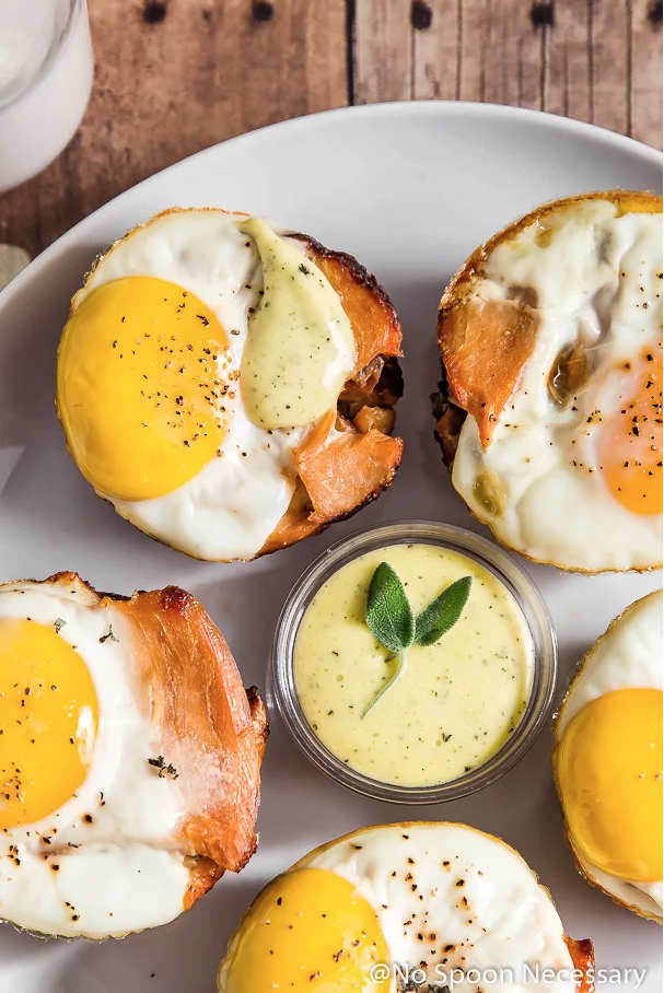 """<p>Treat your holiday guests to a Black Friday breakfast with this recipe. It will keep everyone fueled for a long day of shopping.</p><p><strong>Get the recipe at <a href=""""https://www.nospoonnecessary.com/egg-turkey-stuffin-muffins-with-blender-sage-hollandaise/"""" rel=""""nofollow noopener"""" target=""""_blank"""" data-ylk=""""slk:No Spoon Necessary"""" class=""""link rapid-noclick-resp"""">No Spoon Necessary</a>.</strong></p><p><strong><a class=""""link rapid-noclick-resp"""" href=""""https://go.redirectingat.com?id=74968X1596630&url=https%3A%2F%2Fwww.walmart.com%2Fip%2FNutriBullet-Pro-900-Series-Blender-9-Piece%2F46275746&sref=https%3A%2F%2Fwww.countryliving.com%2Ffood-drinks%2Fg1064%2Fthanksgiving-leftovers%2F"""" rel=""""nofollow noopener"""" target=""""_blank"""" data-ylk=""""slk:SHOP BLENDERS"""">SHOP BLENDERS</a><br></strong></p>"""