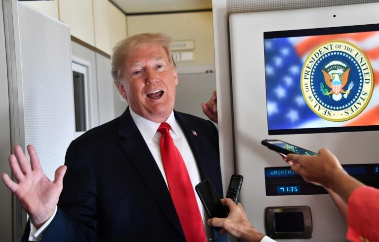 US President Donald Trump told reporters on board Air Force One he was ready to slap tariffs on all Chinese goods imported into the United States