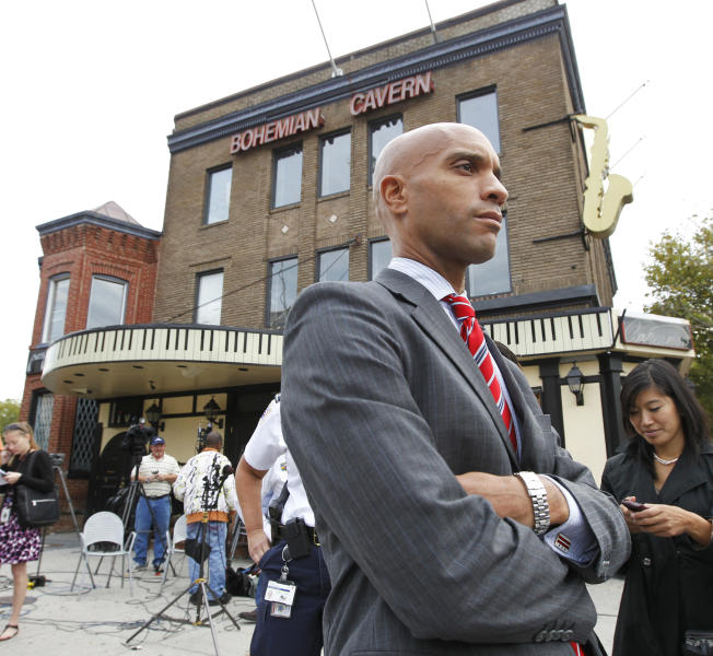 FILE - In this Sept. 29, 2010 file photo, then-Washington Mayor Adrian Fenty waits for the green light on corner of 11th and U Street Northwest in Washington after participating in a news conference. Halfway through what has so far been a scandal-stained first term as Washington's current mayor, Vincent Gray, has trouble emerging from Fenty's shadow, though he defeated him by a hefty margin two years ago. Gray's performance in office has been steady but not splashy. But his winning campaign is the subject of a federal investigation that leaves his political future uncertain. So far, three former aides have pleaded guilty to felonies. Meanwhile, Fenty left a tangible legacy, and his accomplishments and shortcomings are still being debated. (AP Photo/Manuel Balce Ceneta, File)