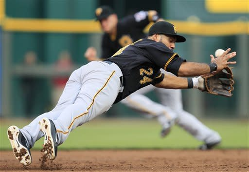 Pittsburgh Pirates third baseman Pedro Alvarez misses a base hit by Cincinnati Reds' Zack Cozart in the third inning of a baseball game, Friday, Aug. 3, 2012, in Cincinnati. (AP Photo/Al Behrman)