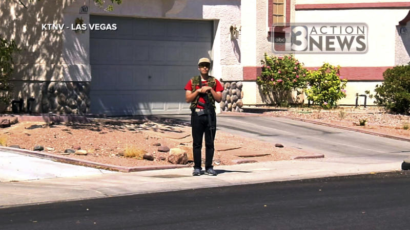 FILE - This Sept. 22, 2016 file photo from video from KTNV 13 Action News shows Conor Climo during an interview while walking a Las Vegas neighborhood, heavily armed. Climo, accused of assembling materials to bomb and shoot people at a synagogue, a bar catering to LGBTQ customers or a fast-food restaurant has been indicted on a federal firearm charge. Climo's appointed defense attorneys didn't immediately respond Tuesday, Sept. 17, 2019 to messages about the indictment filed Sept. 11 in U.S. District Court in Nevada. (KTNV 13 Action News via AP, File)