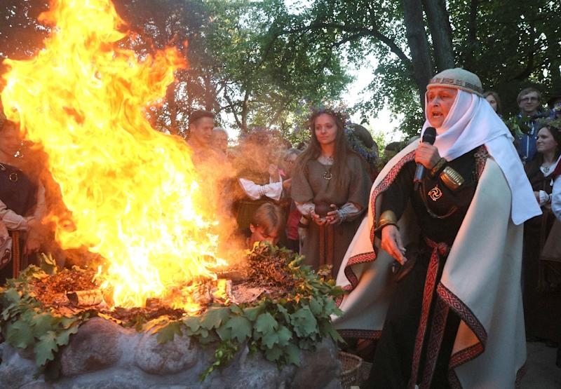 Inija Trinkuniene, high priestess of Lithuania's Romuva neo-pagan community, presides over a fire ritual marking the summer solstice in Vilnius (AFP Photo/Petras Malukas)