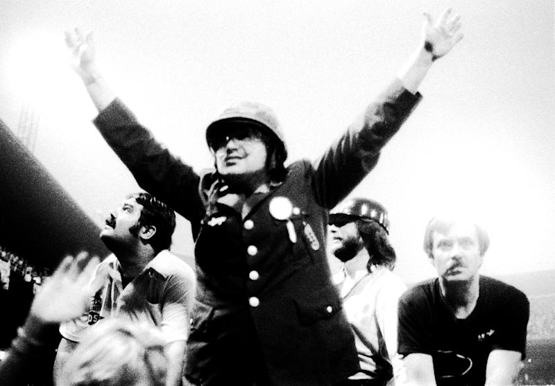 Chicago DJ Steve Dahl leads the crowd in anti-disco chants during the Disco Demolition Night, held at Comiskey Park, in between games of a doubleheader between the Chicago White Sox and the Detroit Tigers, Chicago, Illinois, July 12, 1979. (Photo: Paul Natkin/Getty Images)
