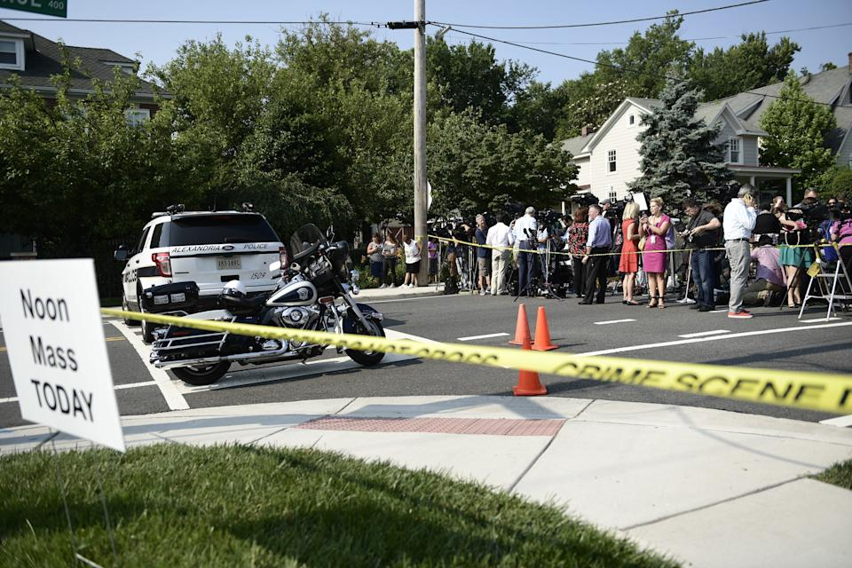 People gather near the scene ofthe shooting.
