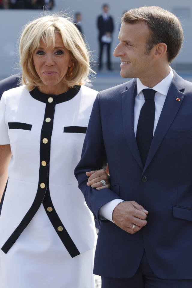 <p>French President Emmanuel Macron and his wife, Brigitte Macron, leave after the traditional Bastille Day military parade on the Champs-Élysées in Paris, France, Saturday, July 14, 2018. (Photo: Philippe Wojazer/Pool Photo via AP) </p>