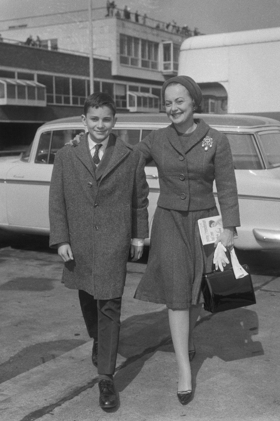 <p>Walking with her son, Benjamin Goodrich, at London's Heathrow Airport. </p>