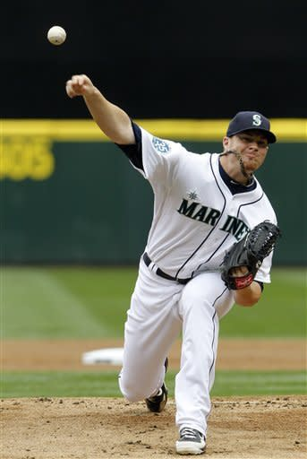 Seattle Mariners starting pitcher Blake Beavan throws against the Minnesota Twins in the first inning of a baseball game Sunday, Aug. 19, 2012, in Seattle. (AP Photo/Elaine Thompson)