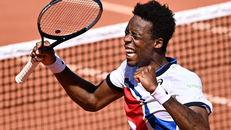 Gael Monfils, pictured here after winning in the opening round at the French Open.