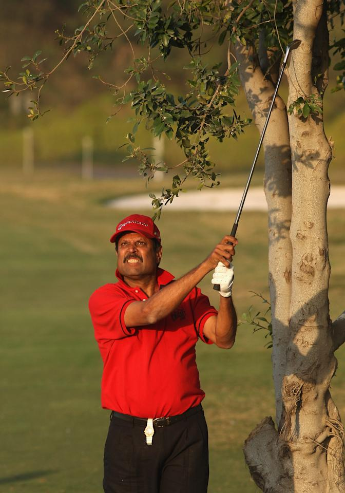 NEW DELHI, INDIA - FEBRUARY 26:  Kapil Dev of India hits his second shot at the 18th hole during the Pro Celebrity Challenge as a preview for the 2008 Johnnie Walker Classic held at The DLF Golf and Country Club on February 26, 2008 in New Delhi, India.  (Photo by David Cannon/Getty Images)