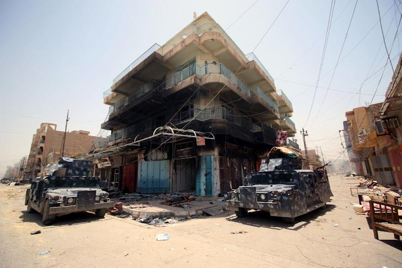 Iraqi military vehicles patrol the streets of Fallujah, after capturing the city from Islamic State fighters on June 27, 2016 (AFP Photo/Haidar Mohammed Ali)