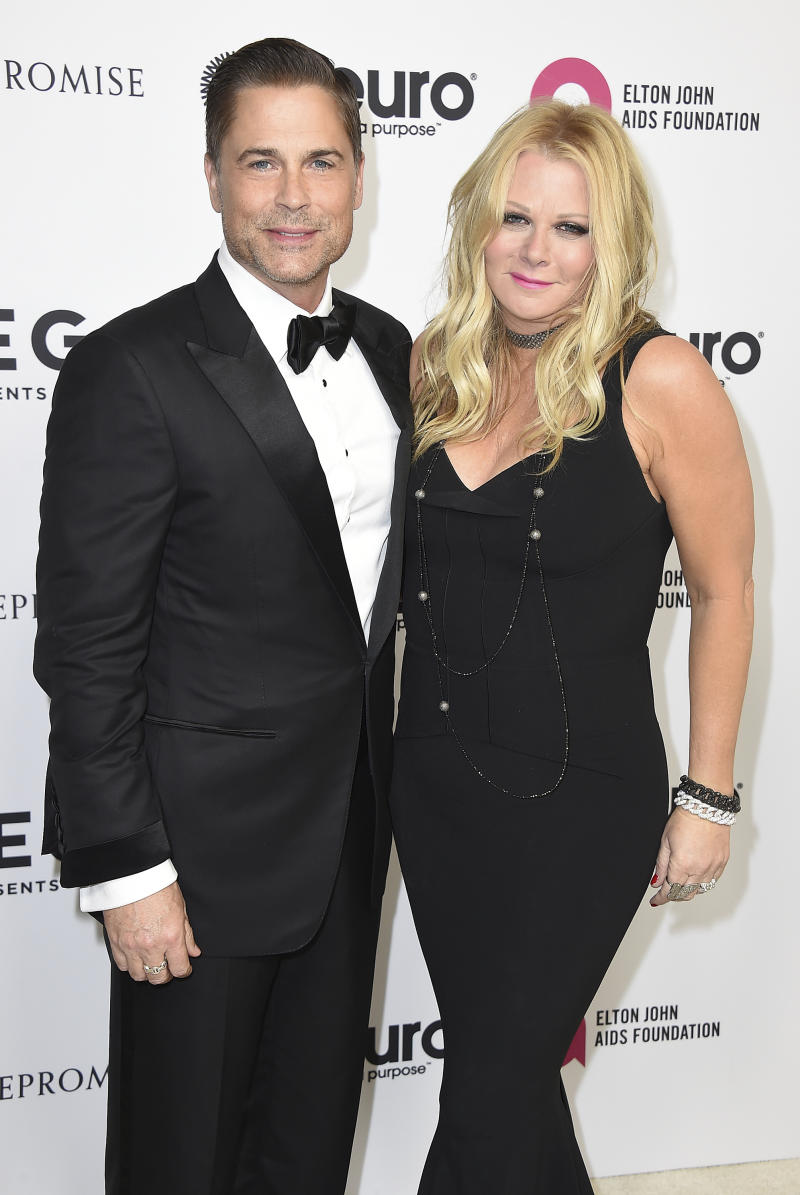 Rob Lowe and Sheryl Berkoff arrive at Elton John's 70th Birthday and 50-Year Songwriting Partnership with Bernie Taupin on Saturday, Mar. 25, 2017 in Los Angeles. (Photo by Jordan Strauss/Invision/AP)