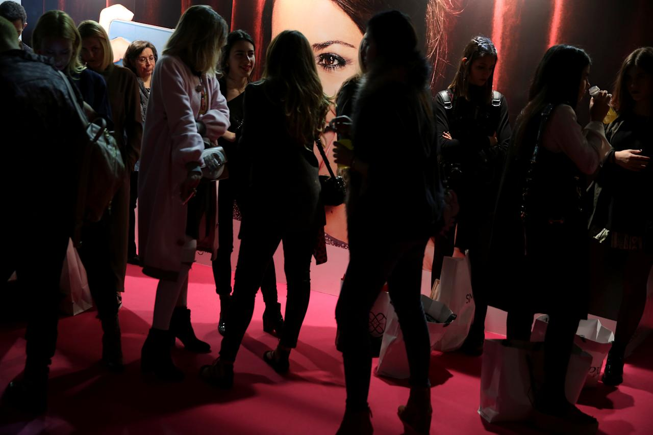 People wait to attend the Jesus Lorenzo's Fall/Winter 2017 show during the Mercedes-Benz Fashion Week in Madrid, Spain February 20, 2017. REUTERS/Susana Vera