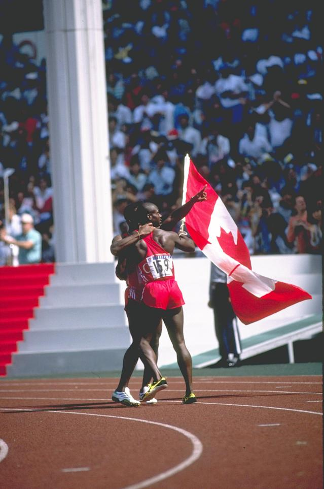 24 Sep 1988: Desai Williams of Canada congratulates Ben Johnson of Canada after the 100 Metres Final at the 1988 Olympic Games in Seoul South Korea. Johnson ran a new World Record time of 9.79 seconds but was later disqualified after a positive drugs test. Credit: Bob Martin/Allsport