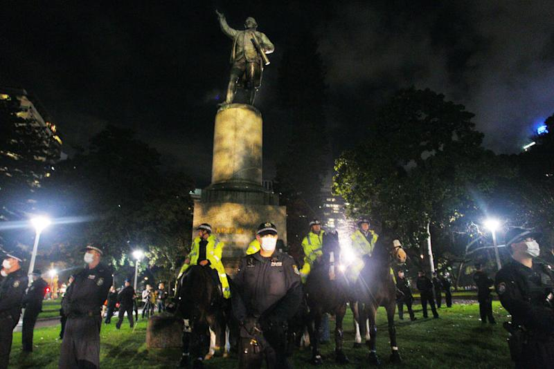 In Sydney over the weekend, police stood guard around a statue of Captain Cook in Hyde Park, in fear it would be vandalised as part of the Black Lives Matter protests. Photo: Getty