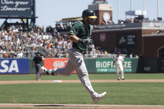 Oakland Athletics' Robbie Grossman runs toward home after hitting a two-run home run against the San Francisco Giants during the sixth inning of a baseball game in San Francisco, Wednesday, Aug. 14, 2019. (AP Photo/Jeff Chiu)