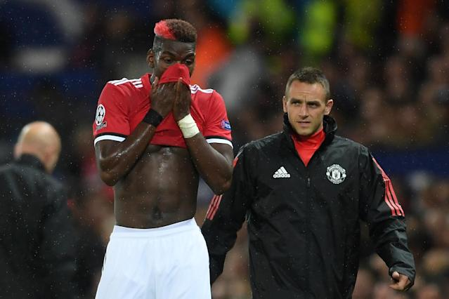 Paul Pogba leaves the field injured at Old Trafford.