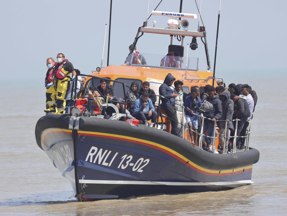 Photo by: KGC-330/STAR MAX/IPx 2021 7/20/21 Record numbers of migrants have been taking advantage of the calm seas in making the channel crossing from Calais to Kent. Here, migrants are brought ashore on July 20, 2021 by Dungeness lifeboat at Dungeness Kent. (Dover, England, UK)