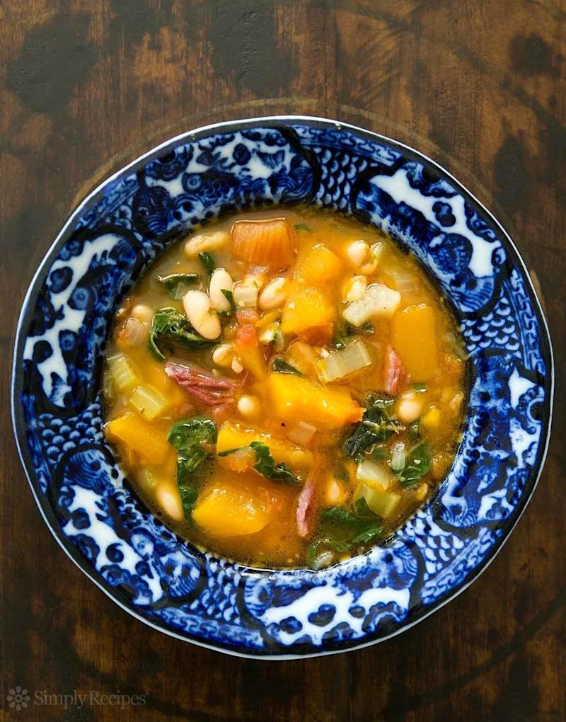 "<strong>Get the <a href=""https://www.simplyrecipes.com/recipes/white_bean_soup_with_pumpkin_and_chard/"" target=""_blank"">White Bean Soup With Ham, Pumpkin and Chard</a> recipe from Simply Recipes.</strong>"