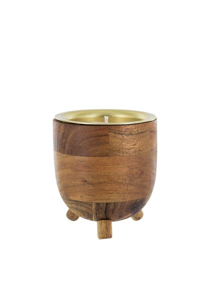 """<p>For fellow wine lovers, this wooden votive containing a complex and earthy fig, cranberry, leather, and violet-scented candle is the golden gift.</p><br><br><strong>Rewined</strong> Pinot Noir Barrel Aged Candle, $31.97, available at <a href=""""https://www.amazon.com/Rewined-Pinot-Noir-Barrel-Candle/dp/B07DPVW8S3/ref=asc_df_B07DPVW8S3/?tag=hyprod-20&linkCode=df0&hvadid=280515187361&hvpos=1o1&hvnetw=g&hvrand=8759134602517843992&hvpone=&hvptwo=&hvqmt=&hvdev=c&hvdvcmdl=&hvlocint=&hvlocphy=9067609&hvtargid=pla-473478385641&psc=1"""" rel=""""nofollow noopener"""" target=""""_blank"""" data-ylk=""""slk:Amazon"""" class=""""link rapid-noclick-resp"""">Amazon</a>"""