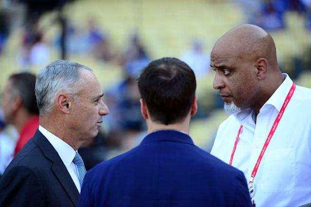 Commissioner Rob Manfred and union chief Tony Clark will be negotiating in private and re-litigating their cases in public as Major League Baseball faces a difficult labor battle ahead of the Collective Bargaining Agreement's expiration after 2021. (LG Patterson/MLB via Getty Images)