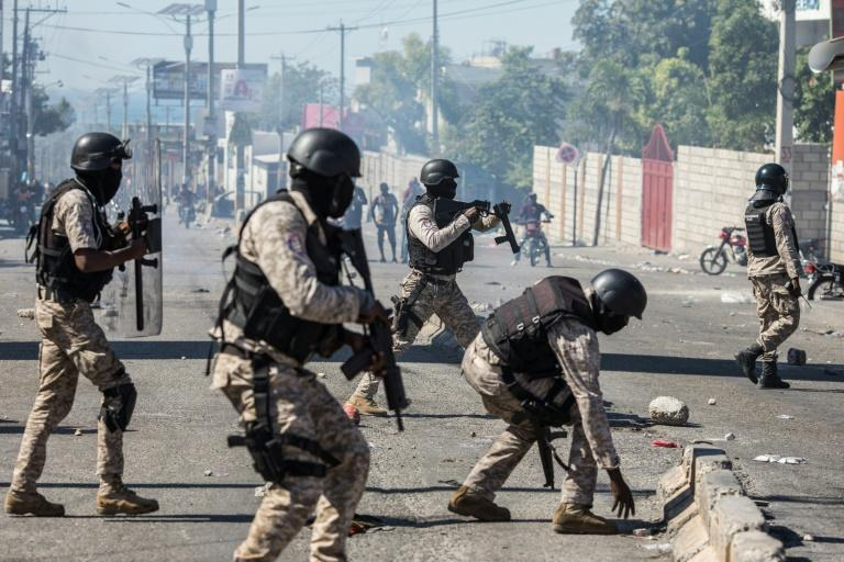 Protesters clash with Haitian police on February 7, 2021 in Port-au-Prince
