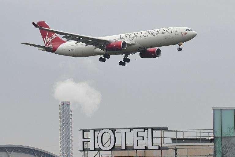 The government says it has signed contracts reserving 4,600 rooms in 16 hotels near English airports