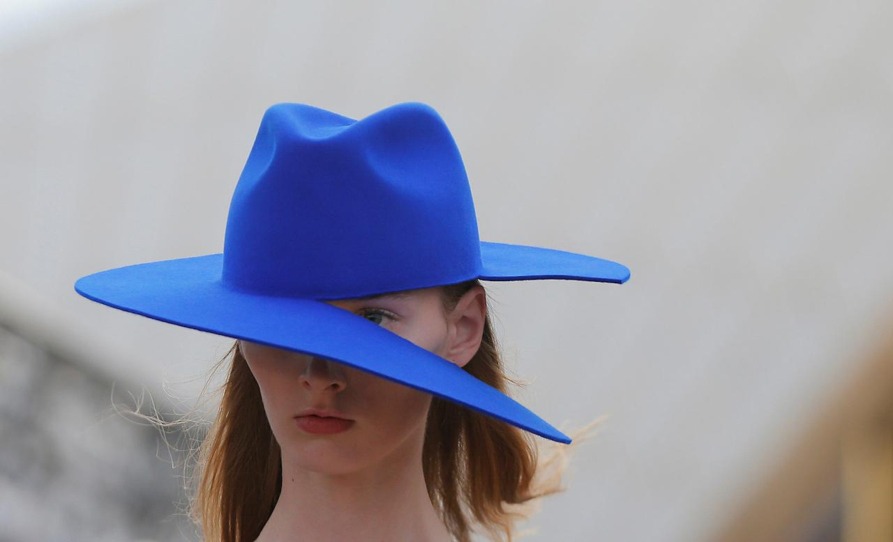 <p>A model presents headwear with a split brim for Australian designer Dion Lee during the first runway show of Fashion Week Australia on the steps of the Sydney Opera House, in Sydney, Australia, May 14, 2017. (Photo: Jason Reed/Reuters) </p>