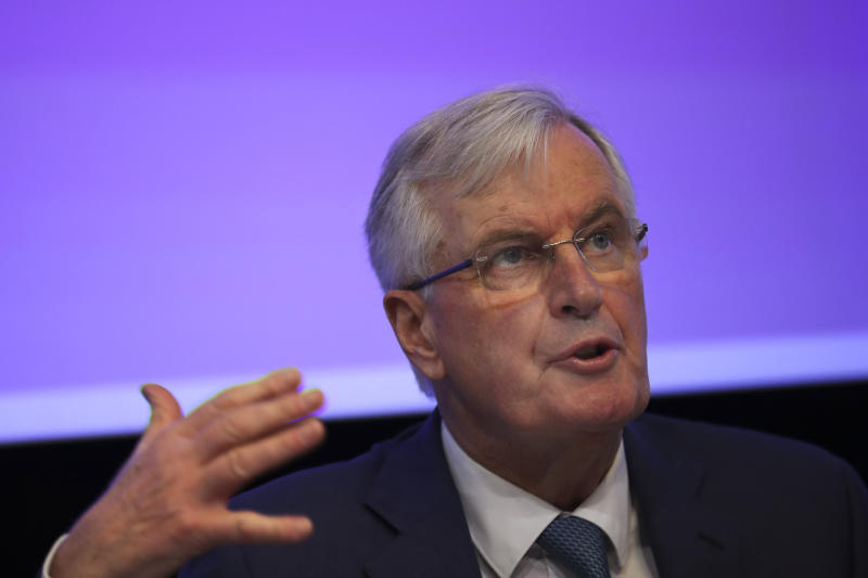 European Union chief Brexit negotiator Michel Barnier talks to the audience during a debate on Brexit at the Charlemagne building in Brussels, Wednesday, Jan. 23, 2019. (AP Photo/Francisco Seco)