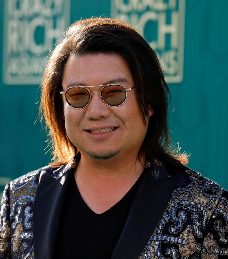"""Author Kevin Kwan poses at the premiere for """"Crazy Rich Asians"""" in Los Angeles, California, U.S., August 7, 2018. REUTERS/Mario Anzuoni"""