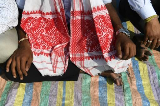 """The gamosa, a red and white cloth, has come to symbolise the struggle of the Indian state's indigenous """"sons of the soil"""" against a new citizenship law"""