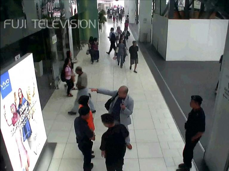 Kim Jong-Nam (C, in grey suit), half-brother of North Korea's leader Kim Jong-Un, pictured at Kuala Lumpur's international airport where he was attacked
