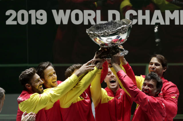 The Spanish team poses with the trophy after Spain defeated Canada 2-0 to win the Davis Cup final in Madrid, Spain, Sunday, Nov. 24, 2019. (AP Photo/Bernat Armangue)