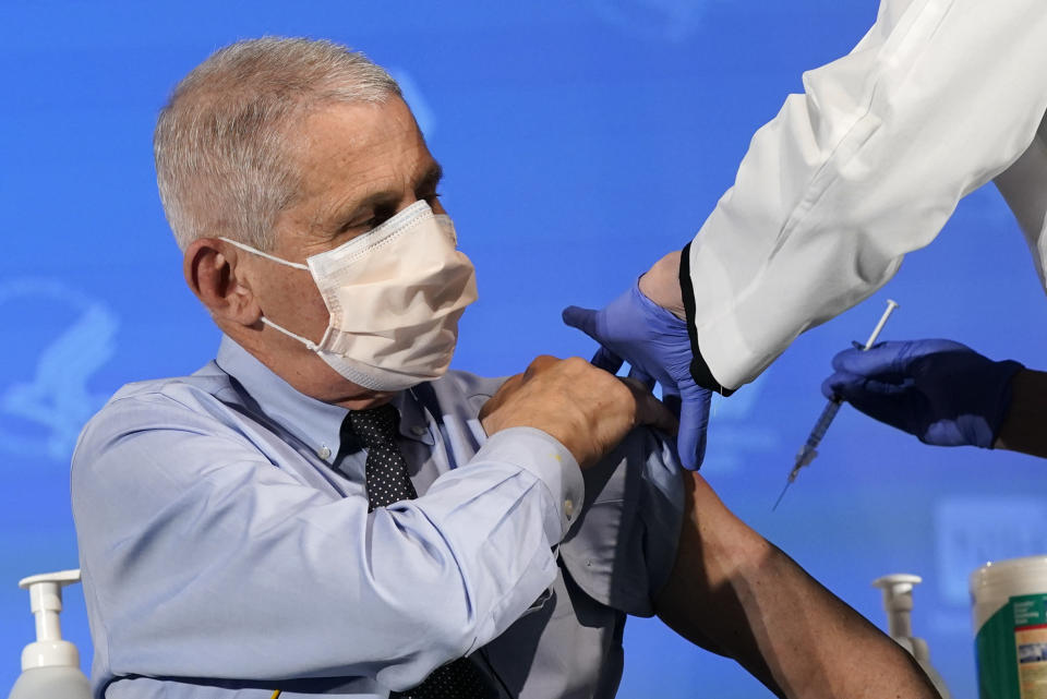 Dr. Anthony Fauci prepares to receive his first dose of the COVID-19 vaccine at the National Institutes of Health in Bethesda, Md., on Dec. 22. (Photo by Patrick Semansky-Pool/Getty Images)