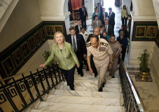 Field Marshal Mohamed Tantawi walks with US Secretary of State Hillary Clinton