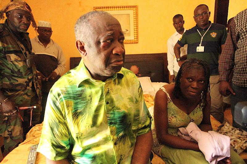 Ivory Coast strongman Laurent Gbagbo and his wife Simone sit on a bed at the Golf Hotel in Abidjan after their arrest on April 11, 2011 (AFP Photo/Aristide Bodegla)