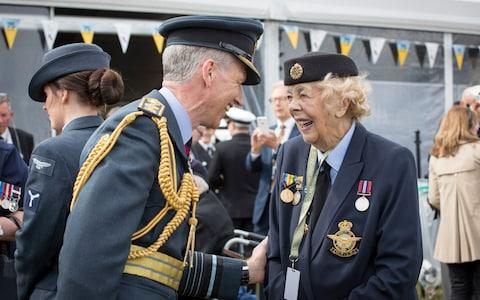British Royal Air Force Chief of the Air Staff Sir Stephen Hillier chats to veteran Bessie Thomas (R), aged 95 during the commemorations for the 75th Anniversary of the D-Day landings in Southsea Common, Portsmouth - Credit: Photo by Cpl Cathy Sharples /BRITISH MINISTRY OF DEFENCE