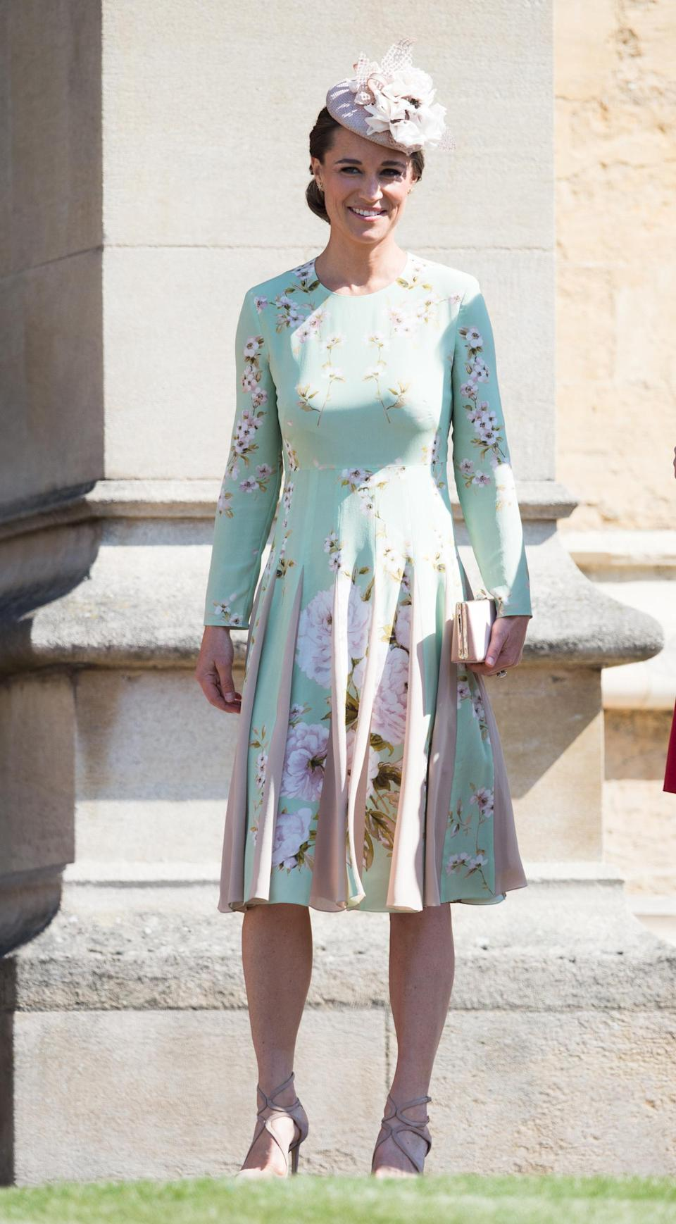<p>To the royal wedding of Prince Harry and Meghan Markle, Pippa wore the pale green Hepburn dress by Fold and Jimmy Choo heels and clutch. <em>[Photo: Getty]</em> </p>