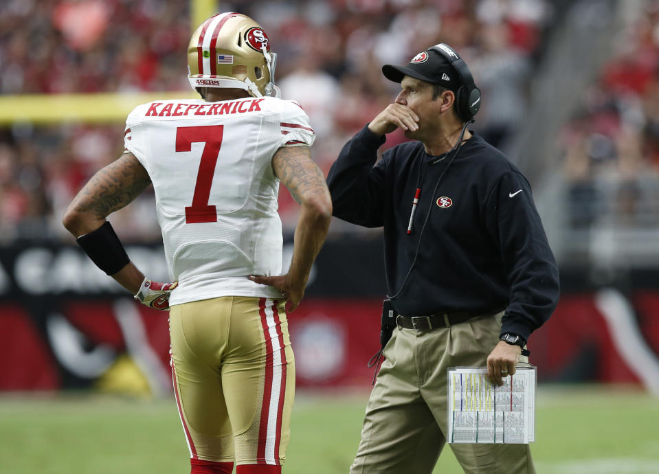 "Jim Harbaugh said that any NFL team that signed Colin Kaepernick would be ""very happy."" (AP Photo/Ross D. Franklin)"