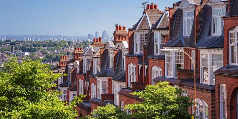 Brick houses of Muswell Hill and panorama of London with Canary Wharf