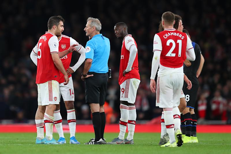 LONDON, ENGLAND - OCTOBER 27: Sokratis Papastathopoulos of Arsenal speaks to referee Martin Atkinson during the Premier League match between Arsenal FC and Crystal Palace at Emirates Stadium on October 27, 2019 in London, United Kingdom. (Photo by Catherine Ivill/Getty Images)
