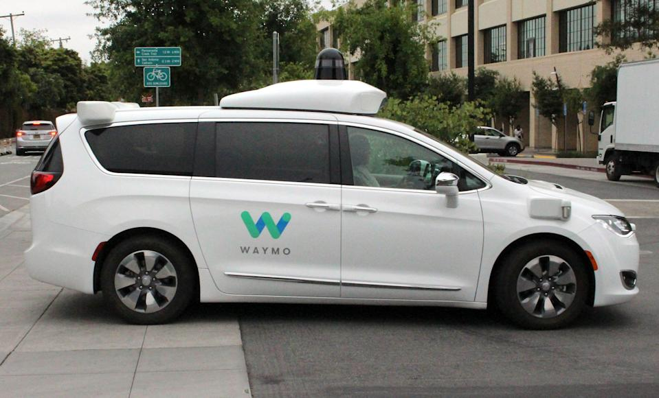 In this file photo taken on May 08, 2019, Waymo self-driving car pulls into a parking lot at the Google-owned company's headquarters in Mountain View, California.