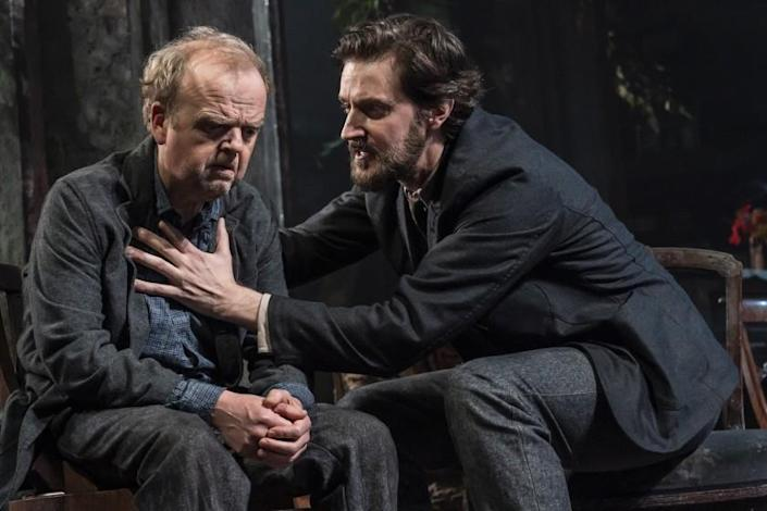 """Toby Jones, left, sitting next to Richard Armitage on stage in """"Great Performances: Uncle Vanya"""" on PBS."""