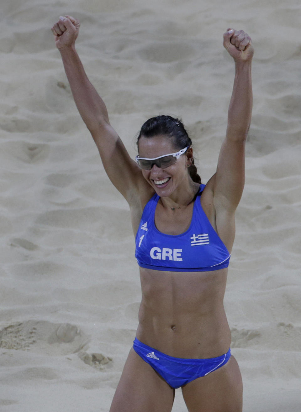 Greece's Maria Tsiartsiani reacts during a beach volleyball match against Switzerland at the 2012 Summer Olympics, Saturday, July 28, 2012, in London. Switzerland won in straight sets. (AP Photo/Dave Martin)