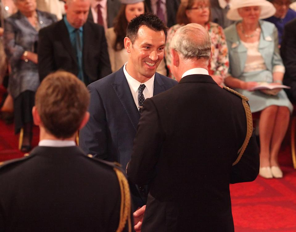 Paul Sculthorpe receiving his Member of the British Empire (MBE) medal from the Prince of Wales at an Investiture ceremony at Buckingham Palace, central London.