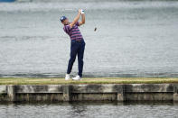 Sergio Garcia, of Spain, hits his third shot on the 13th hole after hitting his tee shot into the water during a round of eight match at the Dell Technologies Match Play Championship golf tournament Saturday, March 27, 2021, in Austin, Texas. (AP Photo/David J. Phillip)