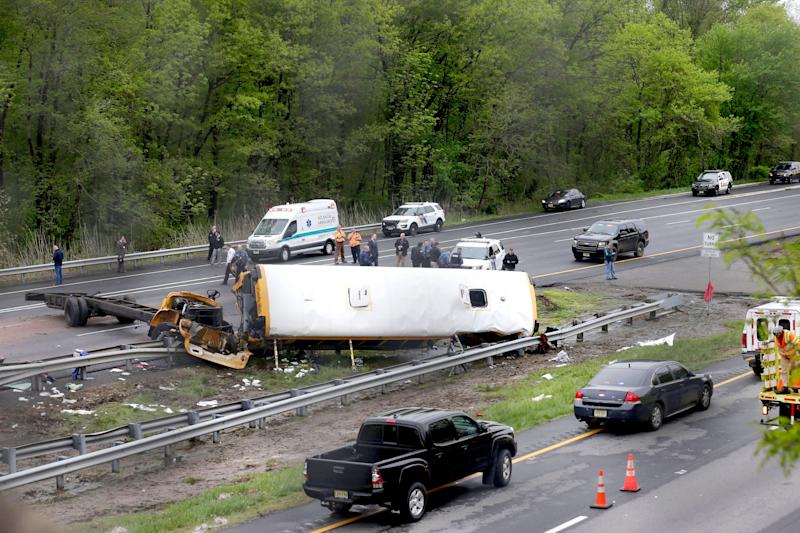 Emergency personnel work at the scene of a school bus and dump truck collision, injuring multiple people, on Interstate 80 in Mount Olive, N.J School Bus Dump Truck Crash - 17 May 2018